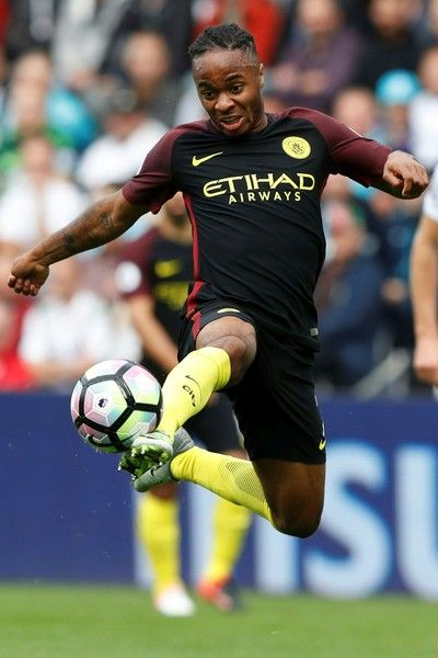 Manchester City's English midfielder Raheem Sterling controls the ball during the English Premier League football match between Swansea City and Manchester City at The Liberty Stadium in Swansea, south Wales on September 24, 2016. / AFP / Adrian DENNIS / RESTRICTED TO EDITORIAL USE. No use with unauthorized audio, video, data, fixture lists, club/league logos or 'live' services. Online in-match use limited to 75 images, no video emulation. No use in betting, games or single…