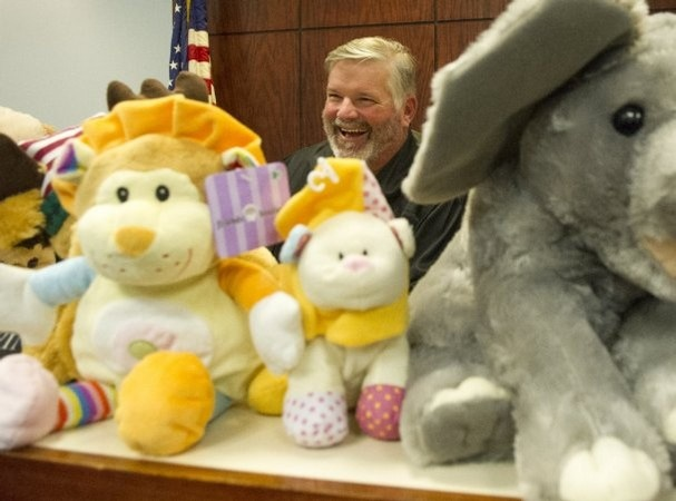 Judge Tim Irwin shows stuffed animals that are given to abused or neglected children in his courtroom Tuesday at the Carey E. Garrett Juvenile Court Building. Irwin said that supplies of the donated animals are running low and new, unused stuffed animals are needed. (ADAM BRIMER/NEWS SENTINEL)