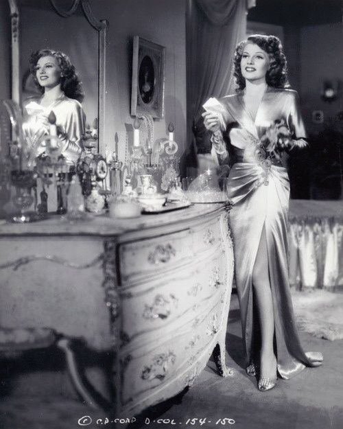 Rita Hayworth at her vanity table - love the 30's-60's styles and love Rita's dress, such a classy lady.