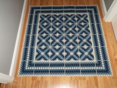 Rug made with plastic canvas and yarn