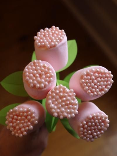 Pink marshmallow flowers Simple (any color you want(marshmallows/put some icing on one end grab some edible colored pearls/go to dollar store grab plastic stems or rip off the flower then shove them in)