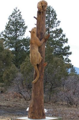 Mountain Lion tree sculpture... would need to be a coon dog instead of a mountain lion though.