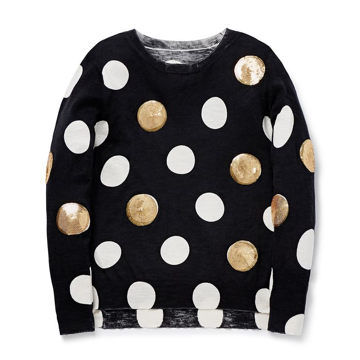 100% Viscose. Long sleeve, lightweight sweater. Features all over spot yardage with gold seguins. Relaxed fitting silhouette. Available in Black.