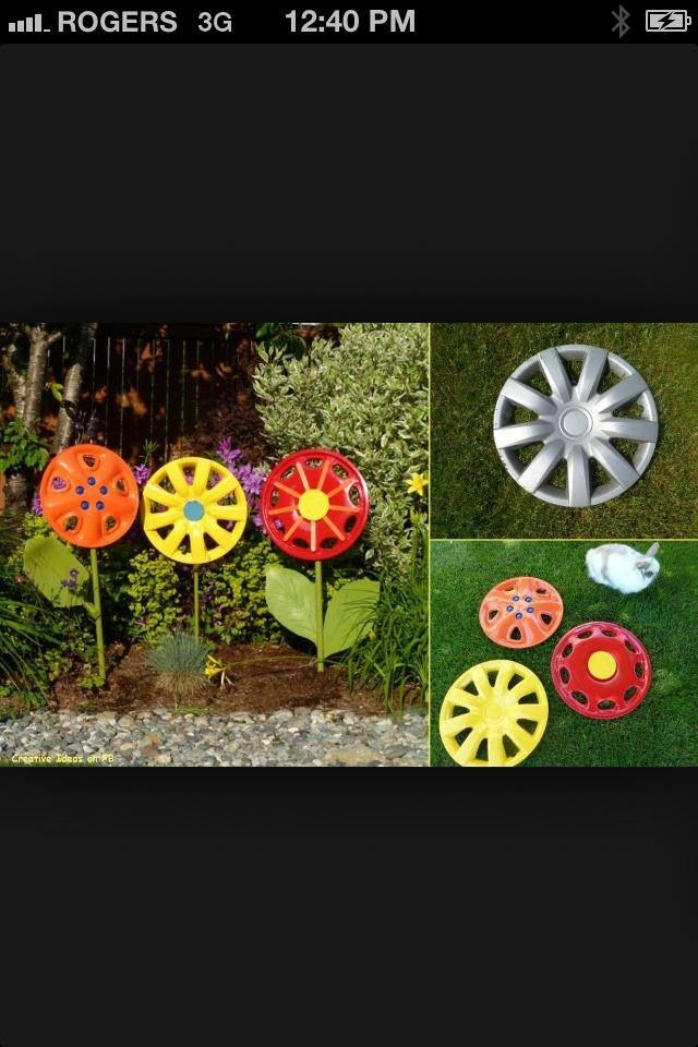 Painted hubcaps made into flowers | Painted hubcaps | Diy ...