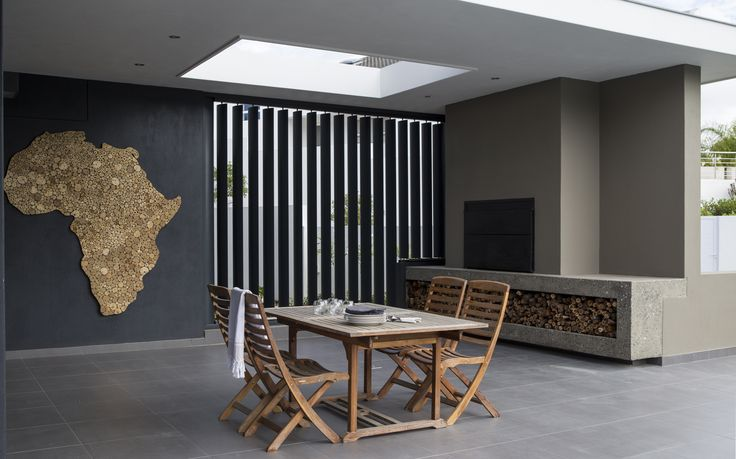 Braai place with architectural features and all open to pool and openplan kitchen/dining/lounge