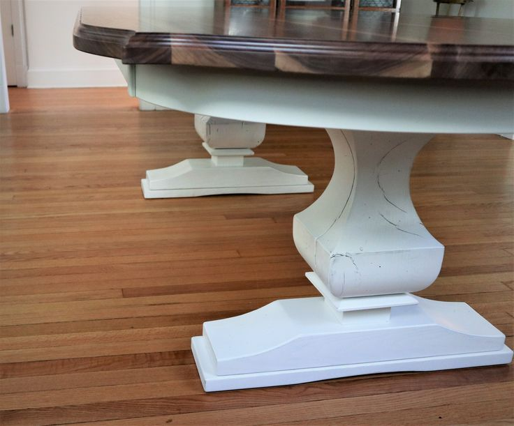 The true definition of contrast with a solid walnut top and whitewash anchor pedestal.
