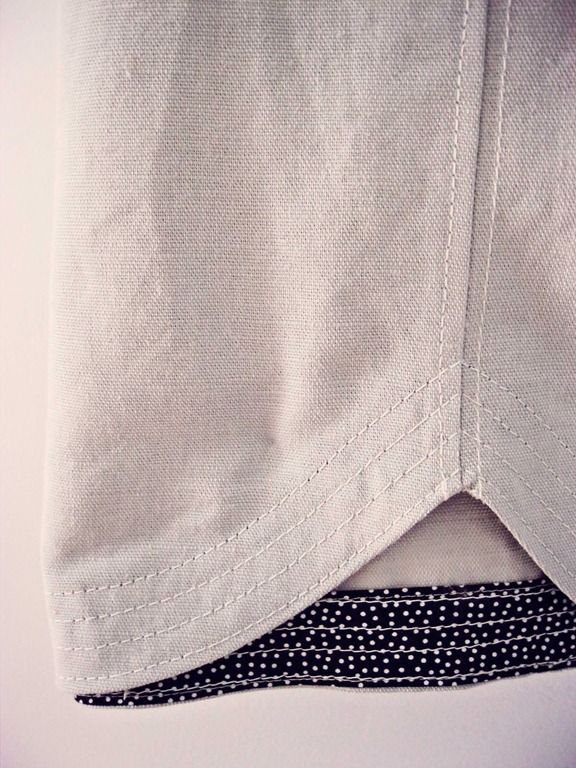 Hemming with different fabric facing, top-stitching.