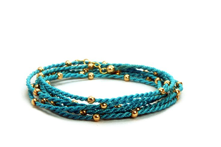 14K Gold filled beads on vibrant long lasting Agua Flax Linen. This is a three in one anklet, bracelet and necklace.  www.TheMacrameProject.com - Handcrafted by Village Women  #jewelry #EthicalFashion #Fashion #WrapBracelet #StackBracelets