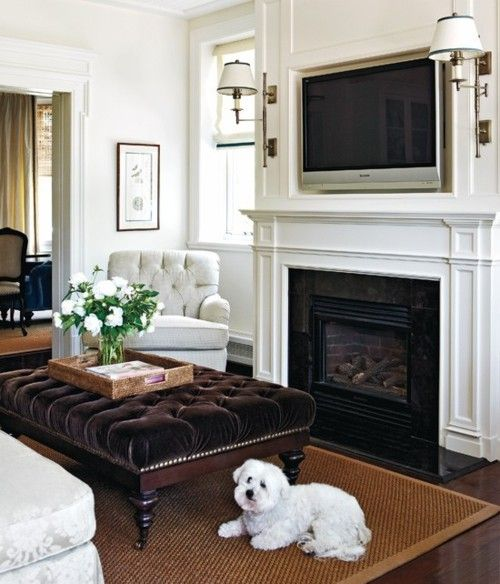 Alternative seating arrangement; armchair on either side of fireplace, couch centered and pulled in away from the wall. Extra large ottoman to replace coffeetable
