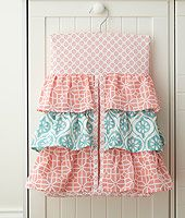 Babies R Us Exclusive! The Fiona Nursery Collection offers an eclectic mix of patterned fabric in coral, aqua and teal. The quilt features a detailed tree scene with a fox, peacock and owl embroidered and appliqued in soft textured fabrics.<br><br>The Levtex Baby Fiona 5 Piece Crib Bedding Set Features:<br><ul><li>The 5 Piece Crib Bedding Set includes a Quilt, 100% Cotton Crib Fitted Sheet, 3-tiered Dust Ruffle, Diaper Stacker and Large Wall Decals.</li><br><li>Offers an eclectic mix of…