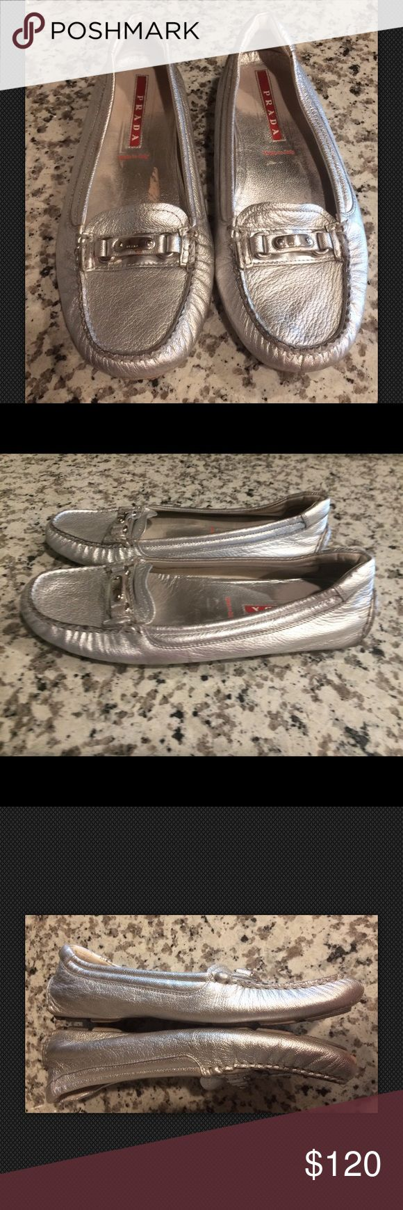 PRADA Women's Silver Leather Driving Shoes PRADA Women's Silver Leather Driving Shoes ~Size 38/US 8~  100% Authentic  Silver leather Silver tone hardware- Prada embossed on front Slide on  Size 38/ US 8  ** Has signs of wear throughout and on inside lining. Some nicks/marks on the leather and under front toe. Still has lots of life left- refer to photos. Auction priced to sell fast!   PRICED TO SELL FAST! PLEASE ASK ANY QUESTIONS BEFORE PURCHASE, THANKS CHECK OUT MY OTHER DESIGNER HANDBAGS…