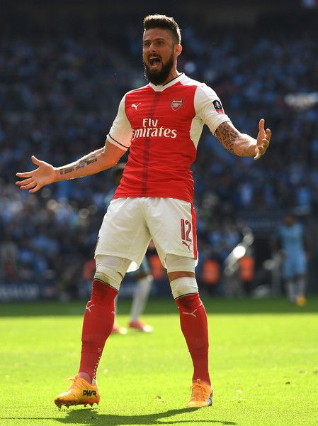 Olivier Giroud Photos Photos - Olivier Giroud of Arsenal celebrates after his side's first goal by Nacho Monreal (not pictured) during the Emirates FA Cup Semi-Final match between Arsenal and Manchester City at Wembley Stadium on April 23, 2017 in London, England. - Arsenal v Manchester City - The Emirates FA Cup Semi-Final