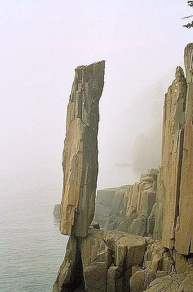 Balancing Rock, Nova Scotia, Canada -- wonder how many men have considered climbing up so they could push it off. . . .