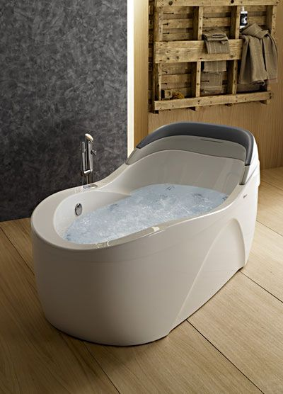 An ergonomic bathtub of comfort and luxury  the Thalia Oval whirlpool tub wraps you in 9 best Ergonomically Correct Tubs images on Pinterest Bath tubs