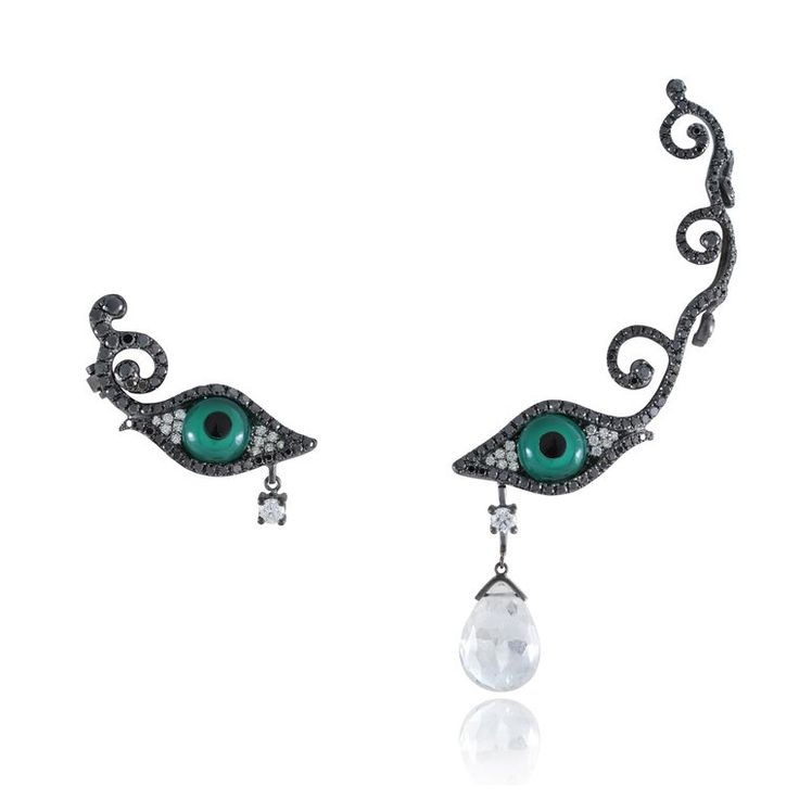 One half ear cuff, one half earring, by Lydia Courteille. The iris of the eyes is crafted from from green agate and the whites filled in with white diamonds with a facted rock crystal tear descends