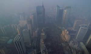 China's Pearl River Delta overtakes Tokyo as world's largest megacity  Buildings are seen through thick haze in the central business district of Guangzhou, part of the Pearl River Delta urban area.