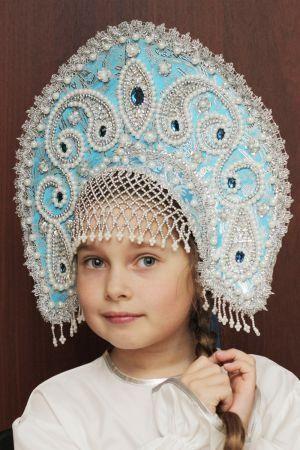 "Russian girl in traditional headdress ""Kokoshnik""."