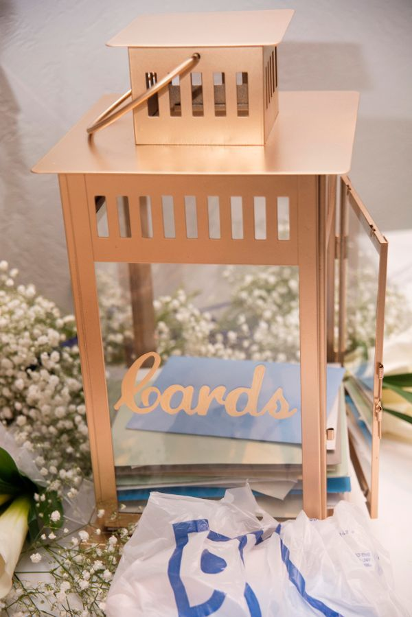 This gold lantern can work as a centerpiece or a place to collect cards. Photographer: Tatum Photo + Design   Venue: Castle Farms - King's Great Hall