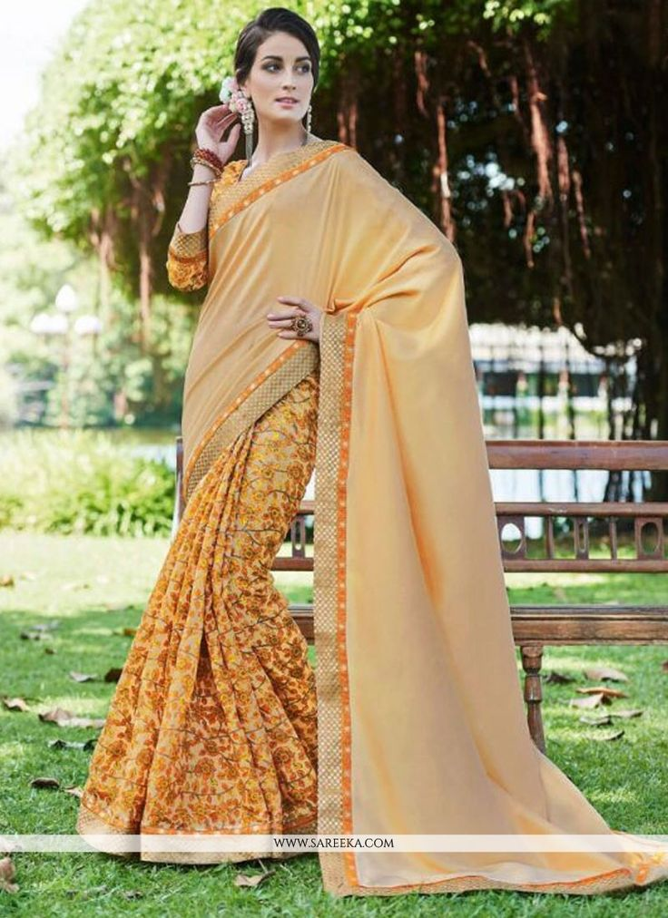 Everyone will admire you when you wear this clad to elegant affairs. An outstanding yellow fancy fabric printed saree will make you look very stylish and graceful. The brilliant attire creates a drama...