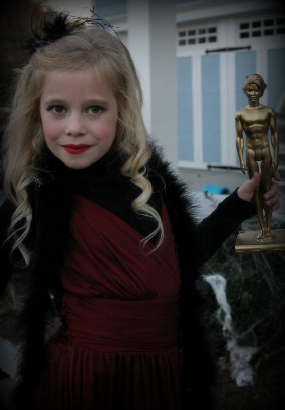Movie Star costume... Used an old Ken doll & some gold spray paint to make the Oscar =)