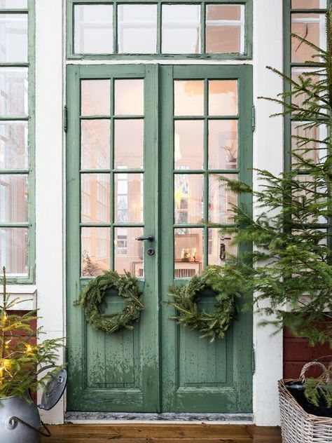thin, double, green front door with windows