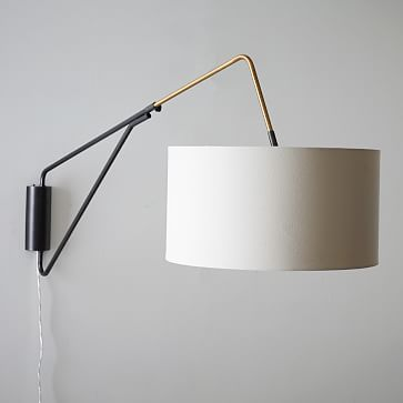 """Mid-Century Overarching Wall Sconce #westelm22""""w x 61""""-73""""d x 33""""h. Wall-mounted body in Antique Bronze finish. Antique Brass finish details. White linen shade with White fabric diffuser at the bottom of the shade. Adjustable arm swivels left or right and extends to desired length. Shade tilts to change direction of light. Clear cord plugs into the wall."""