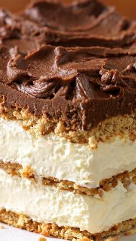 "Graham Cracker Eclair ""Cake"" ~ Delectably airy treat includes graham cracker layers that become cake-like and soft from the pudding."