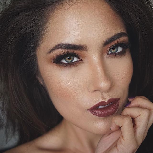 SULTRY BEAUTY LOOK Eyes: Apply a layer of matte, medium brown eyeshadow to the entire eyelid and over the tear duct and under the lower lash line. Line the eye in a dark brown eyeliner, and softly smudge some of the eyeliner on the lower lash line using a Q-tip. Apply one coat of volumizing mascara to all lashes, then a lengthening mascara on top of the upper lashes.  Cheeks: Apply some soft, neutral brown blush to the apples of your cheeks  Lips: Fill in your lips with a plum lipliner.