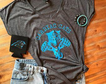 Carolina Panthers Cardiac Cats shirt, Womens Carolina Panthers clothing, womens NFL Panthers attire, greg olen, Carolina football, nc football, bank of America stadium, charlotte nc, nfl clothing, womens Carolina panthers, trendy nfl shirts, womens shirts, womens Carolina shirts vintage