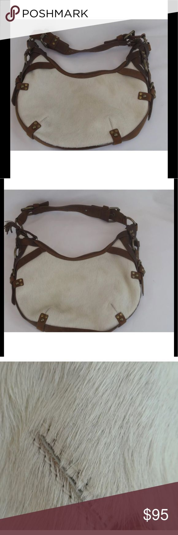 """Cole Haan Pony Hair Purse For your consideration is this Cole Haan G-series  purse with ivory colored pony hair exterior and brown leather strappings. 1 zippered inside pocket Lined adjustable straps  Measurements: 13 """" by 1"""" deep  with a height of 8""""at the longest measurements  Condition:  Very good to excellent  pre-owned used condition with very little to no use wear visible and coming from a non smoking home. Cole Haan Bags Satchels"""