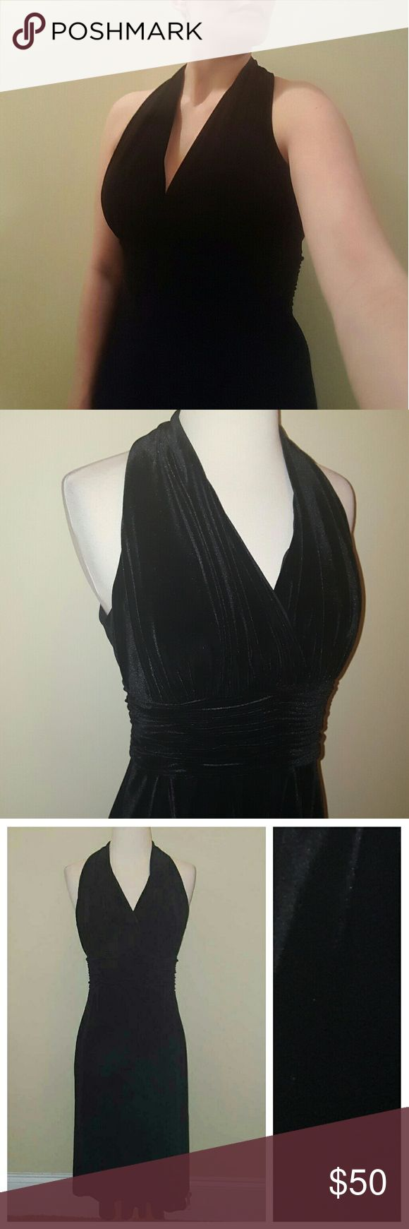 """Beautiful Black Velvet Dress Sweet yet sexy black velvet dress!  Awesome neckline and cut!  Comfortable and nice!  Not for the bustier ladies though!  Flowy bottom!  Great cocktail dress!  Measurements  Bust 32"""" Waist 32"""" Length 42""""   Thanks for shopping! Evan Picone Dresses"""