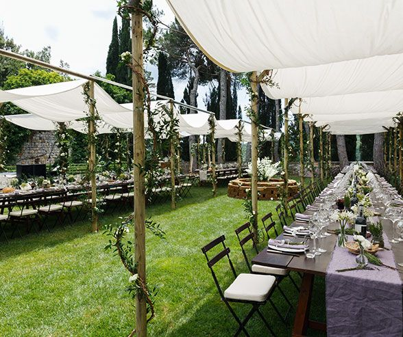 Canopies are decorated with Italian ruscus, grapevine, roses and jasmine.