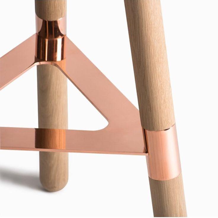 A metal and wood barstool.