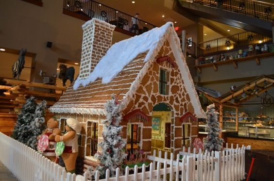 Life Size Gingerbread House - The house was made from:    * 3,240 eggs    * 1,320 pounds of sugar    * 750 Christmas cookies    * 600 pounds of gingerbread dough    * 100 pounds of chocolate    * 500 holly leaves    * 2,000 blue chocolate wafers    * 2,000 green chocolate wafers    * 4,900 pretzel rods    * 5,000 Christmas candies    * 750 candy wreaths    * 1,000 candy canes