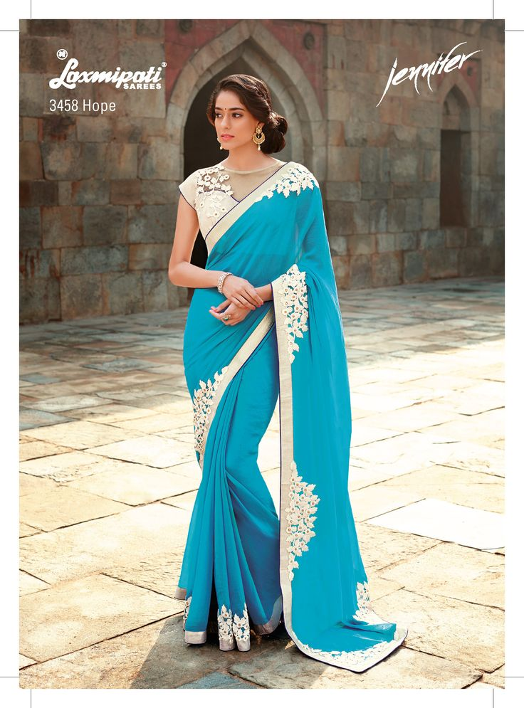 """ Beauty is being the best possible version of yourself on the inside and out."" - This impressive cyan color saree with floral resham embroidery patch diamond studded make you to feel angelic. The resham embroidery on net blouse with silver brocade inner enhances its beauty to a great extent."