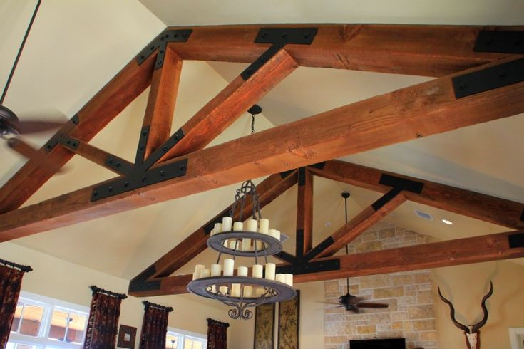 Timber frame trusses in family room at a ranch home for Timber frame ranch homes
