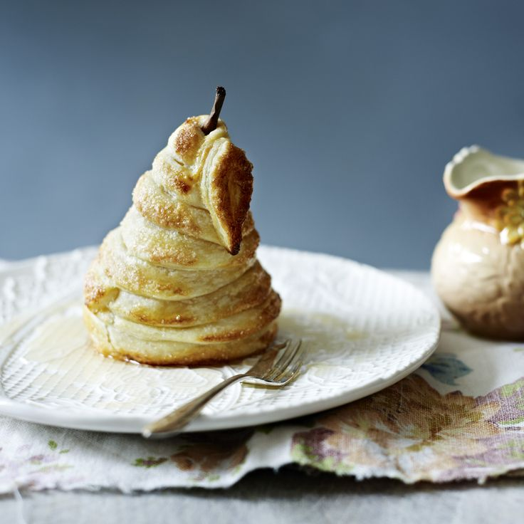 A riff on the fruit tart that is a work of art and a dessert. This poached pear pie uses easy-to-make rough puff pastry.