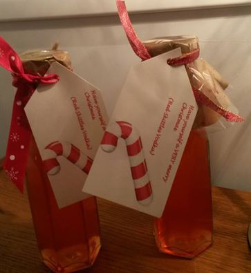 Strawberry Skittles vodka. Made for Christmas gifts and decanted into kilner bottles, finished with brown paper, cellophane and an oversized tag!