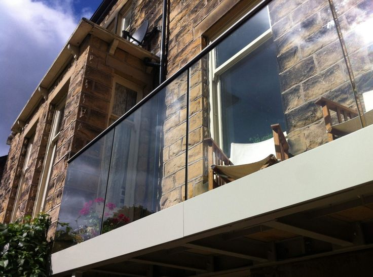 Steel Base and Structural Glass Balcony with Hidden Fixings