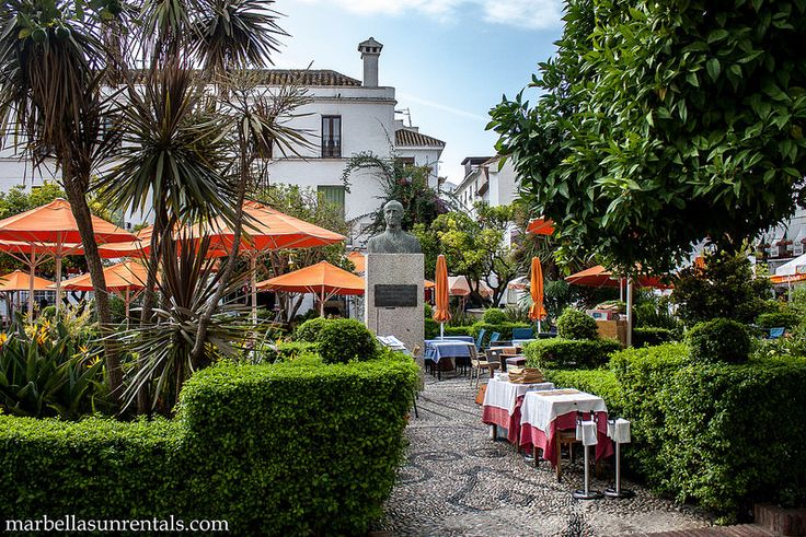 Orange Square with tables and statue of king