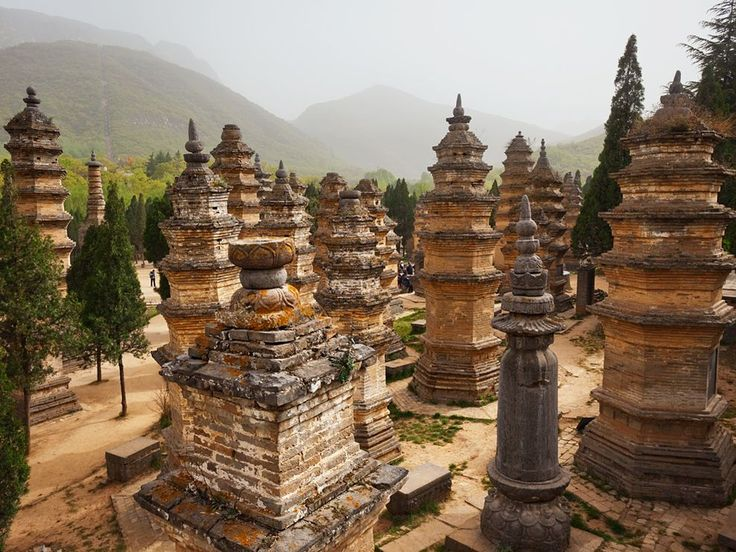 """""""Gained merit in battle"""" reads the epitaph of two of the 231 eminent Shaolin monks honored with shrines in the Pagoda Forest. The number of layers in a shrine reflects a monk's virtue; his bones, and often those of disciples, are buried below."""