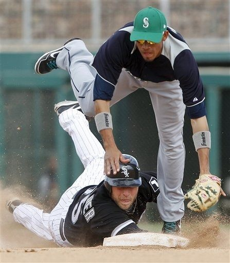 Seattle Mariners second baseman Gabriel Noriega gets up ended by Chicago White Sox's Jim Gallagher