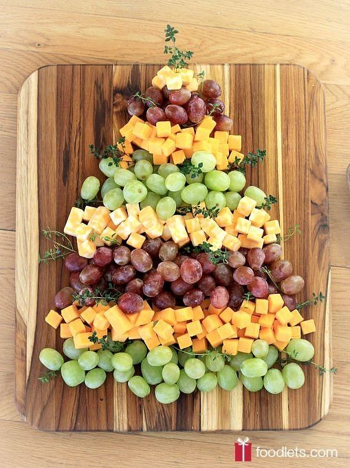 Christmas Tree Grapes & Cheese Platter. Just the easiest no-sugar holiday party snack ever. Pile up cheese, pile up grapes, repeat. by bettie