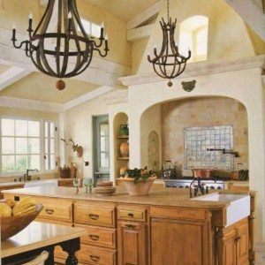 Tuscan Kitchen With Exposed Beam Ceiling And Rustic Chandeliers Over Island With Ceramic Sink And Faucet And Range With Large Hood And Silver Backsplash And Pot Filler , Timeless Tuscan Kitchen In Kitchen Category
