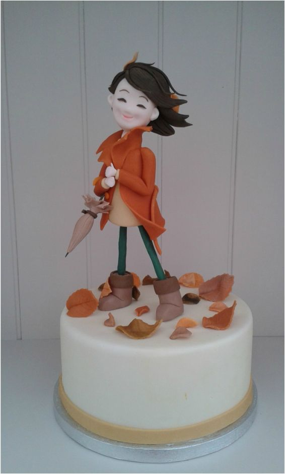 Autumn Girl Cake based on a tutorial by Carlos Lischetti made by Lara's Theme Cakes with umbrella and leaves