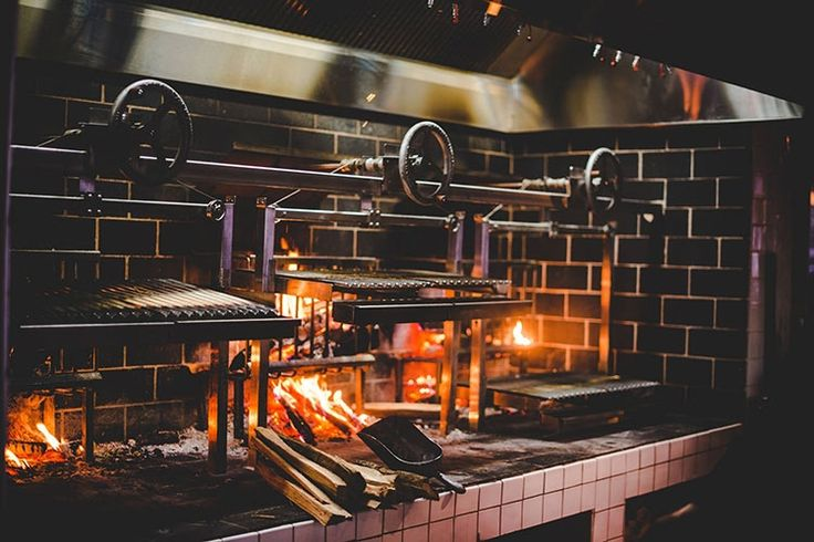 Flavorful sausages and tender cuts of beef and pork are cooked up on Rural Society's famed wood-fired grill. (Photo: facebook.com/RuralSocietyDC)
