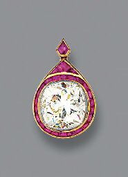 A DIAMOND AND RUBY PENDANT. The cushion-shaped diamond weighing 6.30 carats to the calibré-cut ruby pear-shaped surround, with French assay marks.