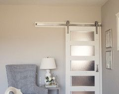 more modern take on barn door for bathroom divider between powder room & shower room