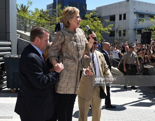 Ailing Killary can't make a short speech without being propped up. Look at that grip!