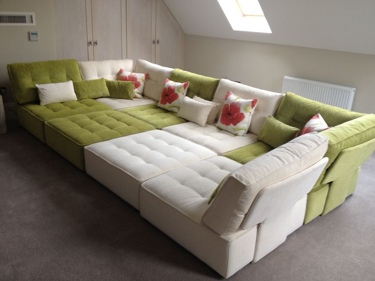 I've just bought a gigantic tapas sofa the size f two double beds put together and in a velvet in colours teal lime green purple it will go a roos my entire living room the whole width of the room very cosy with my wood burning stove burning and chunky knit throws and a giant plasma screen a mix between a winter snug and a cinema room